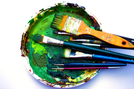 colors paint: Paint brushes to the painting palette with colors on a white background.
