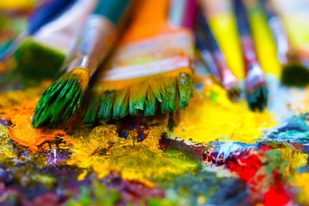 colors paint: Paint brushes to the painting palette with colors Stock Photo