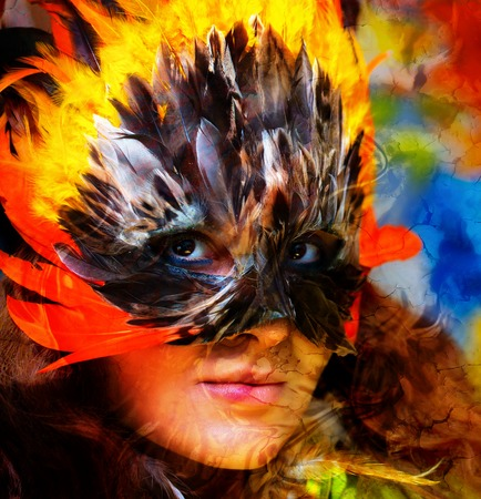 mask woman: Young woman with feather carnival face mask. Woman goddess and crackle effect