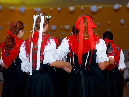 slovak: young dancing women in traditional folk dress on wedding feast ceremony