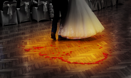 dancefloor: bride and groom dancing on a wedding dancefloor with rose petals in heart shape