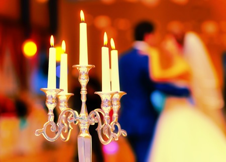 candle holder: wedding decorative candle holder and dancing bride and groom on background. wedding concept Stock Photo