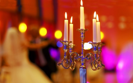 wedding decorative candle holder and dancing bride and groom on background. wedding concept
