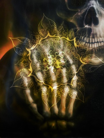 skeleton hand: Painting  skull and skeleton hand, on black background and ornamental mandala. Airbrush painting Stock Photo