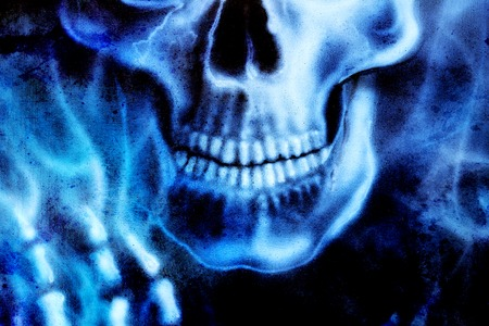 skeleton hand: detailed skull and skeleton hand and blue fire, on black background