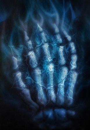 heart chakra: Painting skeleton hand, on black background and ornamental mandala. Airbrush painting