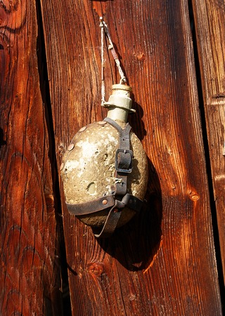assemblage: antique old style retro object assemblage on a wooden wall. rustic stile. Old canteen Stock Photo
