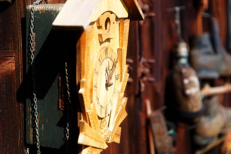 assemblage: antique old style retro object assemblage on a wooden wall. Cuckoo clock Stock Photo