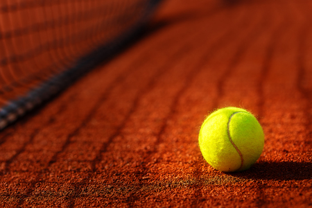 tennis court with tennis ball and antuka background