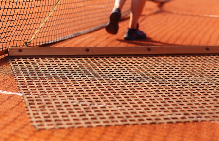 aligning: Aligning surface tennis court, with pulling network