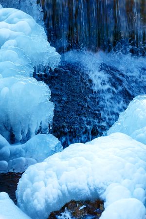 cataract falls: Winter scene with water falling from icy rocks Stock Photo