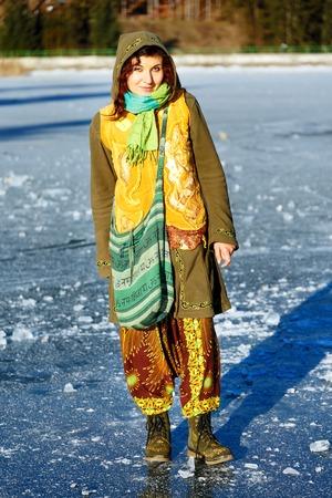 ethno: .woman on ice lake in beautiful ethno dress