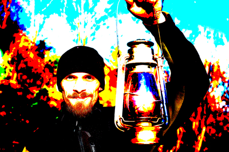 loy: young handsome man in sport outfit holding old lantern. Computer effect