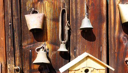 assemblage: antique old style retro object assemblage on a wooden wall. rustic stile. Old sheep bell Stock Photo