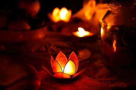 beautiful enchanting lotus shape candlelabre with burning candle Stock Photo