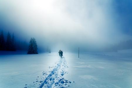 adult footprint: People alone in Winter blizard. Beautiful mountain snowy landscape Stock Photo