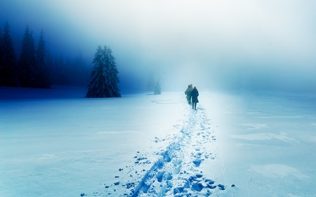 alone person: People alone in Winter blizard. Beautiful mountain snowy landscape Stock Photo