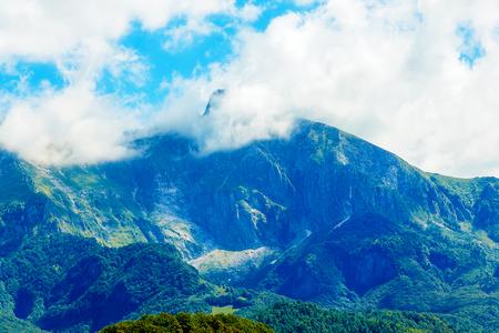 Beautiful landscape. Beautiful peaks in the clouds