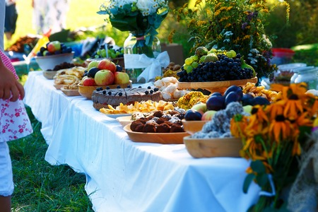 wedding feast: Meals on table of abundance as a part of natural wedding ceremony held in nature Stock Photo