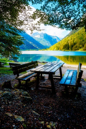 Beautiful landscape. Wooden bench overlooking the lake and mountains