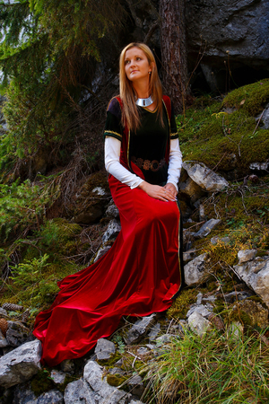 cultic: beautiful girl in a historical costume in forest. and light graphic effect.