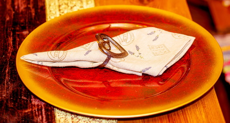 beautiful structured plate with linen napkin and heart shape buckle. Stock Photo