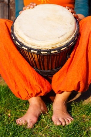 Young lady drummer with her djembe drum. Stock Photo