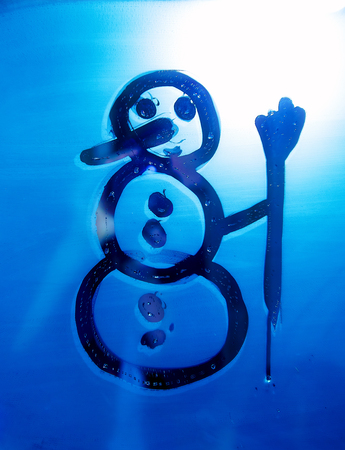 reflection in mirror: Snowman on the bathroom mirro. Drawing on Mirror. Stock Photo