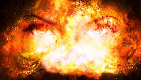 宇宙背景の女性の目。眼との接触。火災の効果。 写真素材
