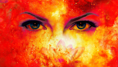 Woman eyes and lotus flower in cosmic background. Eye contact. Fire effect.