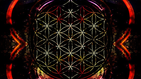 heart chakra red: Flower of life on black background and light effect. Sacred geometry. Stock Photo