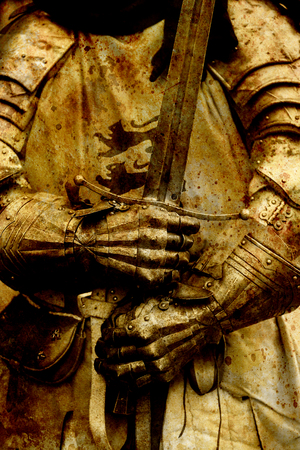 showpiece: Detail knight armor. Gloves and sword of a knight.