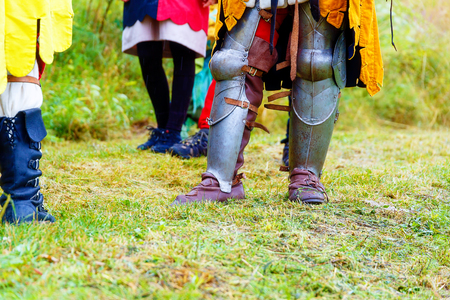 showpiece: Medieval armor shoes on meadon. Detail shoes. Stock Photo