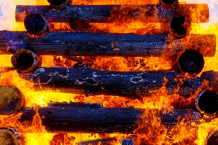 beautiful structure of burning logs and flames of great bonfire.