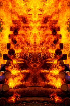 beautiful structure of burning logs and flames of great bonfire. Mirror effect.
