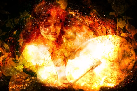 shamanic girl with frame drum on abstract structured space background. Fire element.