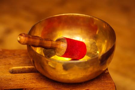 Beautiful Tibetian bowl with golden light reflections. Stock fotó - 104653160