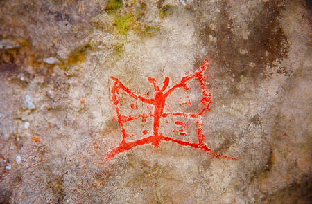 Red butterfly on wall. Imitation cave painting, Stock Photo