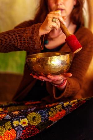 spiritual girl immersed in meditative sounds of tibetian bowl. Stock fotó