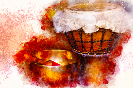 beautiful djembe and tibetian bowl and softly blurred watercolor background.