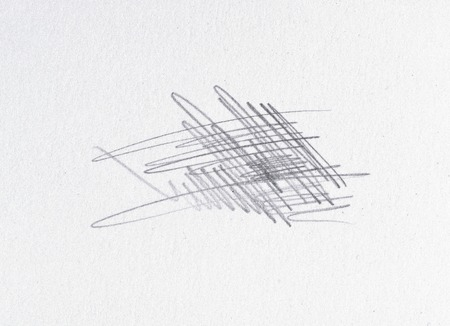 Multiple linear pencil scratches on blank paper surface.