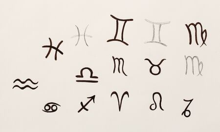 Hand drawn horoscope astrology symbols on paper.