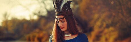 beautiful shamanic woman with headband in the nature.
