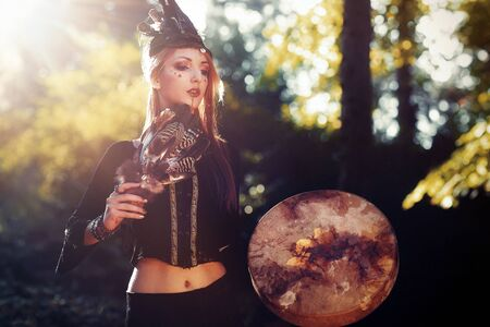 Shaman woman and shamanic feathers on denim. 写真素材