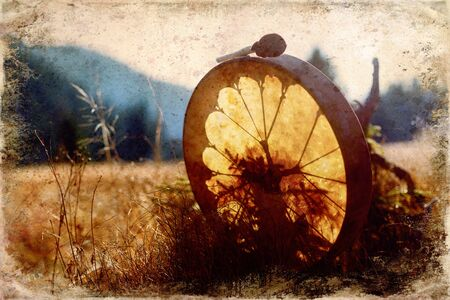 shamanic drum in nature, shamanic drum, old effect and border
