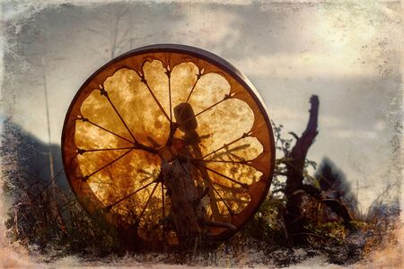 shamanic drum in nature, shamanic drum with crystal, old effect and border