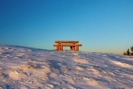 Wooden bench in winter landscape, beautiful landscape scenery