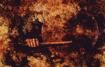 shamanic drum in woman hand and grunge background Banco de Imagens