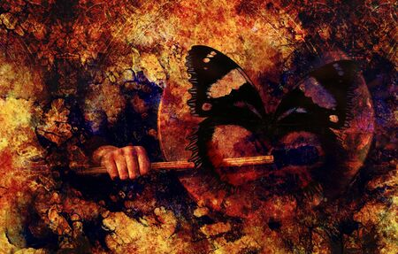 shamanic drum in woman hand and butterfly