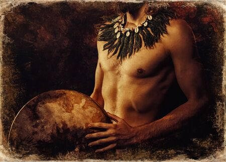 beautiful shamanic man with headband and necklace